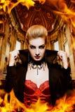 Female vampire. In a burning church Stock Image