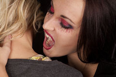 Female vampire bite womans neck Stock Images