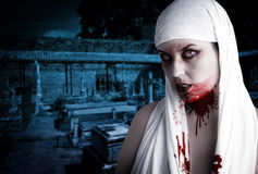 Female vampire with blood stains Stock Images