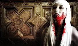 Female vampire with blood stains. In a cemetery. Gothic Image halloween Stock Photography