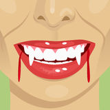 Female vampire bloody mouth showing fangs Stock Photography