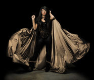 Female Vampire With Cloak. Over dark background Royalty Free Stock Images