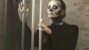 Female vampire crazing in catacomb with lattice. In full HD stock video footage