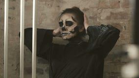 Female vampire crazing in lattice. In full HD stock video footage