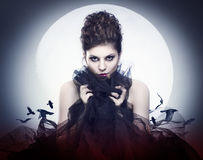 Female vampire. Lovely young female vampire in the night moon stock photos