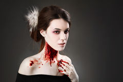 Female vampire. Portrait of a female vampire over black background Stock Photos