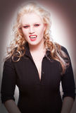 Female vampire. With red eyes an white skin Royalty Free Stock Image