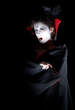 Female vampire showing fangs Stock Photo