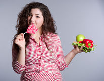 Female vegetarian with vegetables and candy Stock Photography