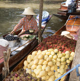 Female vendor at floating market in Thailand Stock Images