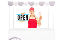 Female vendor holding an ice cream cone Stock Photo