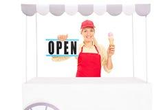 Female vendor holding an ice cream cone Stock Photo