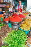 Female vendor working at a stall at the Klong Toey Market royalty free stock photography