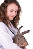 A female vet holding a rabbit Royalty Free Stock Photo