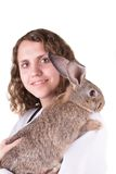 A female vet holding a rabbit Royalty Free Stock Photography