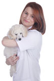 Female vet with poodle puppy Stock Photography