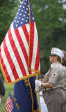 Female Veteran in uniform with American Flag Stock Photos