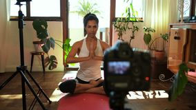 Female video blogger recording video about yoga 4k