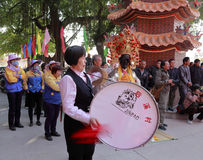 Female villager play western drum. Female villager beat drum in the courtyard of xiacheng city god temple at chengnei village, houxi town, amoy city, china royalty free stock image
