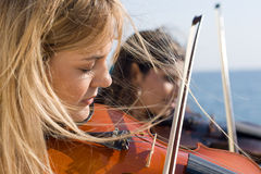 Female violin players Royalty Free Stock Images