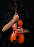 Female Violinist Holds Bow Across Saturated Musical Violin Royalty Free Stock Photo