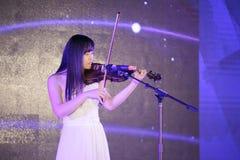 Female violinist play carefully Stock Photo