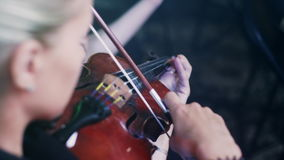 Female violinist playing violin. Violin player playing music. Woman play violin stock video footage