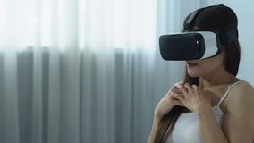 Female in virtual reality headset playing game, modern technology, innovation. Stock footage stock video