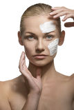 Female visage with cream Stock Photography