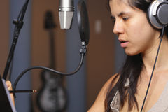 Female vocal artist in a recording studio Royalty Free Stock Images