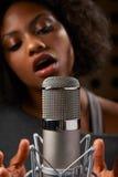Female Vocalist In Recording Studio Stock Image
