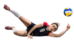 Female volleyball player reaching the ball on the ground isolated Stock Photo
