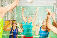 Female volleyball team in action during the match Royalty Free Stock Image