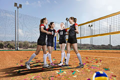 Female volleyball team on volleyball court Royalty Free Stock Images