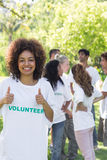 Female volunteer gesturing thumbs up Stock Images