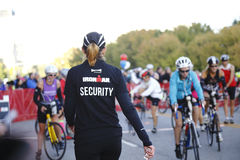 Female Volunteer at Ironman Triathlon Stock Photo
