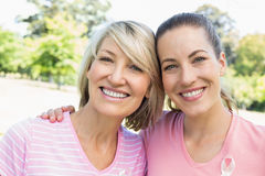 Female volunteers participating in breast cancer awareness. Portrait of confident female volunteers participating in breast cancer awareness at park Royalty Free Stock Photography