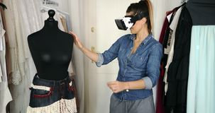 Female in VR headset working in parlour stock footage