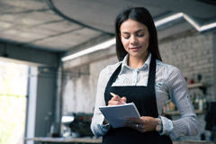 Female waiter in apron writing order Stock Photos