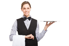 Female waiter holding an empty dish Stock Photos