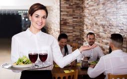 Female waiter showing country restaurant Stock Image