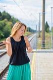 Female waiting train on the platform Stock Photo