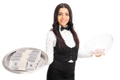 Female waitress holding a tray with money Stock Photo