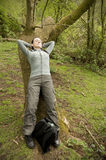 Female walker asleep on log Stock Image