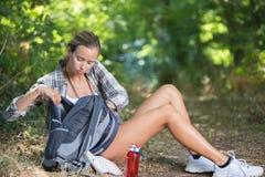 Female walker having break Royalty Free Stock Photography