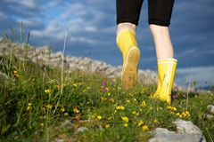Female walking in boots outdoors Royalty Free Stock Image