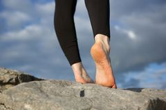 Female walking on rock barefoot Royalty Free Stock Photography
