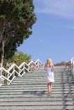 Female walking up the stairs Stock Images