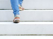 Female walking upstairs Royalty Free Stock Photography