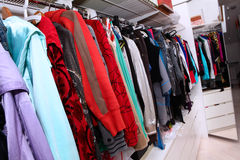 Female wardrobe. Home interior with female clothing hanging on Stock Photography